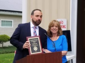 Dr. David Leach Receives Outstanding Service Award from the Warwick Area Migrant Committee